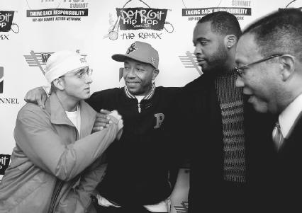 From left, rapper Eminem, Russell Simmons, Detroit mayor Kwame Kilpatrick, and Dr. Benjamin Chavis, CEO of the Hip-Hop Summitt, backstage at the 2003 Detroit Hip-Hop Summitt. AP/Wide World Photos. Reproduced by permission.